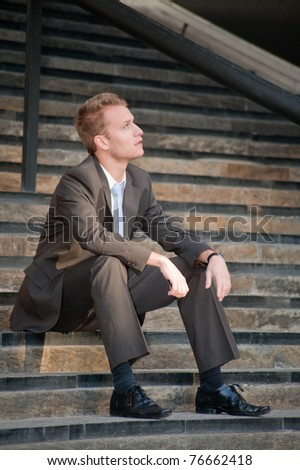 Young business man looking to the future - stock photo