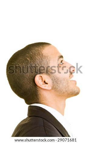 Young business man looking up - stock photo