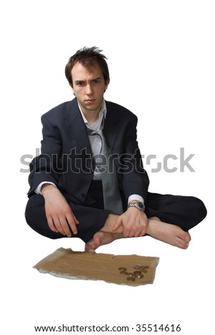 Young business man made redundant begs, only got some change - stock photo