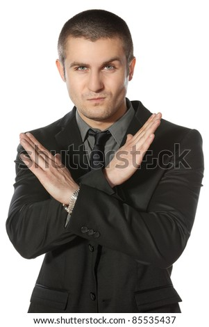 Young business man making enough gesture over white background - stock photo