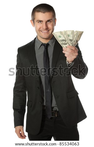Young business man offering pack of Euro money over white background - stock photo