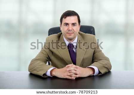 young business man on a desk at the office - stock photo