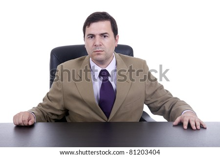 young business man on a desk, isolated on white - stock photo