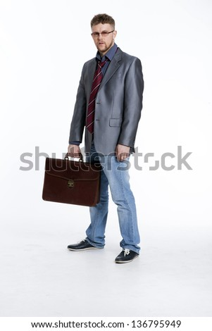 Young business man on his way to work, rest, talking, sitting, reflects