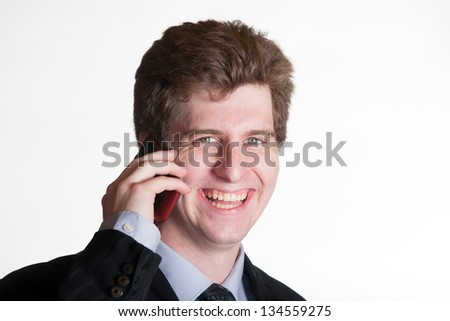 Young business man on the cell phone portrait