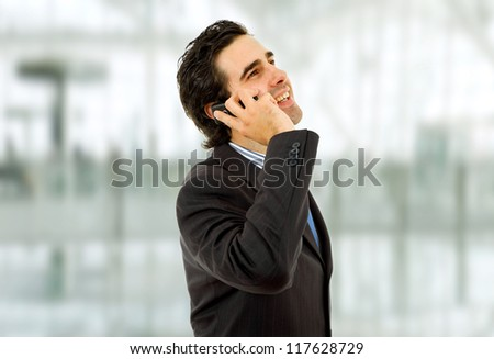 young business man on the phone at the office - stock photo