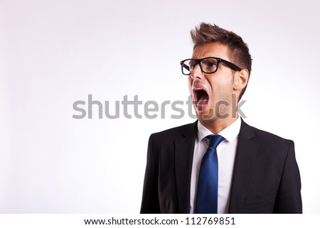 young business man or student screaming to his side - stock photo