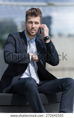 young business man outdoor with cell phone