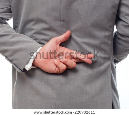 Young business man over white background. Cheating his his fingers crossed - stock photo