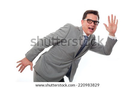 Young business man over white background. Saying goodbye - stock photo