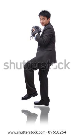 Young Business man pitching baseball - stock photo