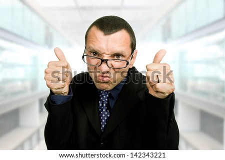 young business man playing silly at the office - stock photo