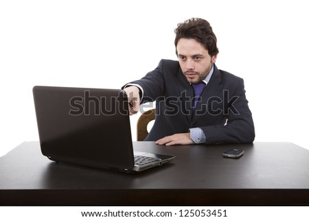 young business man pointing at laptop screen