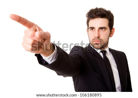 Young business man pointing at something interesting on a white background - stock photo