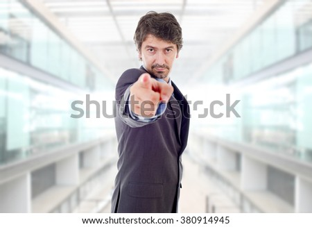 young business man pointing, at the office - stock photo