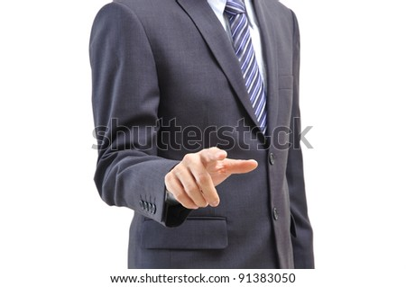 Young business man pointing at you isolated white background - stock photo
