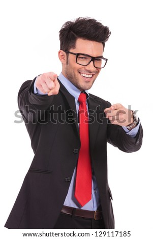 young business man pointing towards the camera with both hands and smiling, isolated on a white background - stock photo