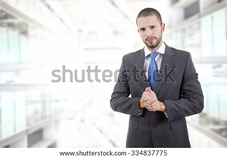 young business man portrait at the office building - stock photo