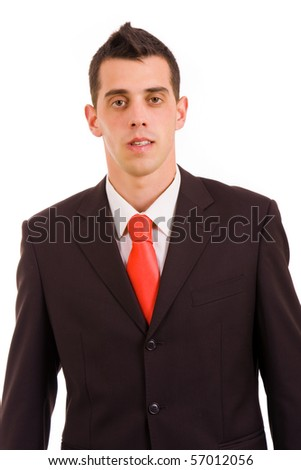 Young business man portrait, standing looking at the camera
