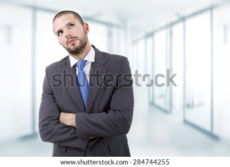 young business man portrait thinking at the office - stock photo