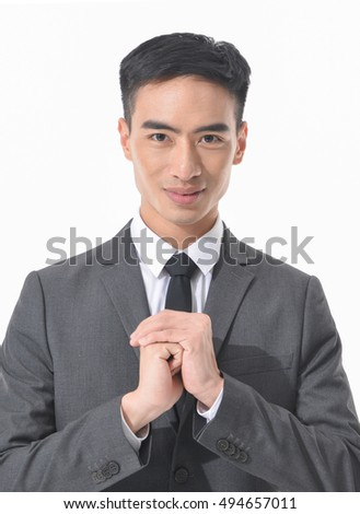 Young business man posing with hands gesture isolated