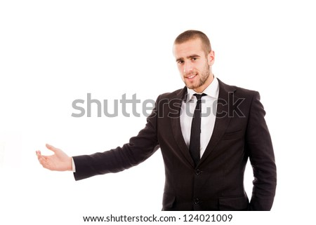 Young business man presenting over white background - stock photo