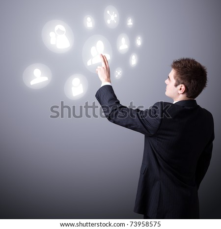 Young business man pressing a digital social network icon. - stock photo
