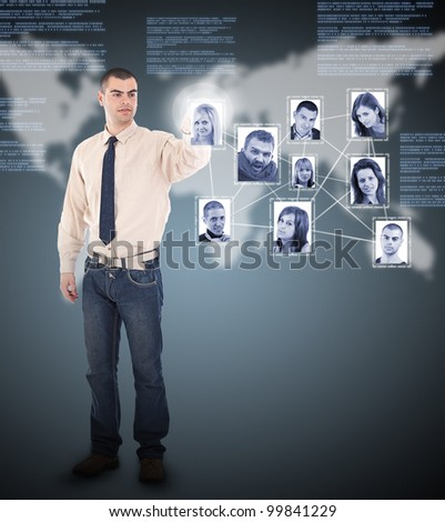 Young business man pressing Social network pictures in digital futuristic background - stock photo