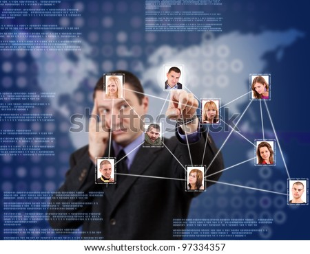 Young business man pressing Social network pictures in digital futuristic blue background - stock photo