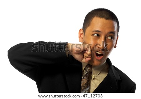 Young business man punch himself isolated on white background - stock photo