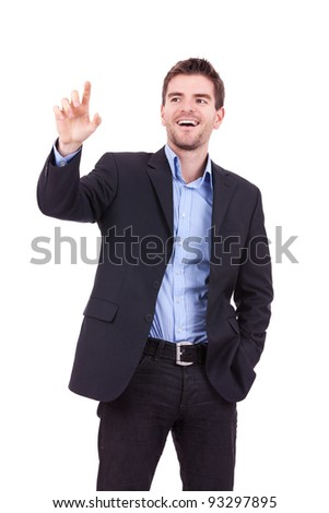 Young business man pushing imaginary buttons on white