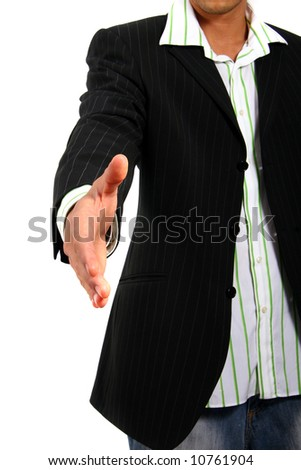 Young business man reaching out his hand for a handshake. Isolated over white. - stock photo