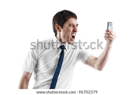 young business man screaming in his cellphone over white - stock photo
