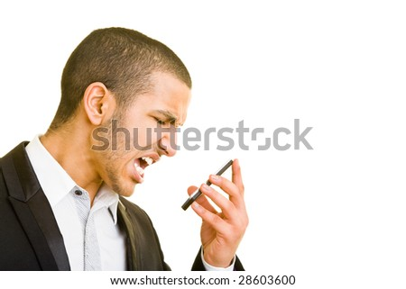 Young business man screaming into his mobile phone