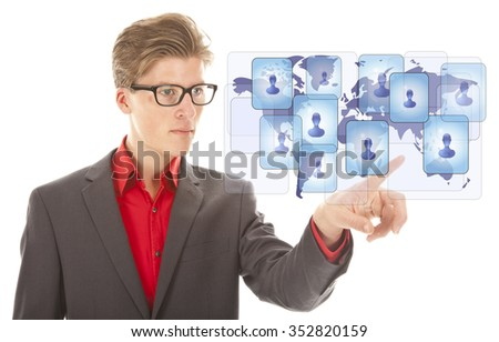 Young business man selecting virtual worldwide friends isolated on white background - stock photo