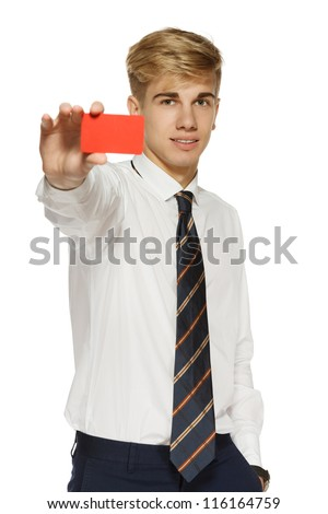 Young business man showing a blank business card over white background - stock photo