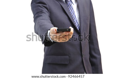 Young business man showing his phone isolated on white - stock photo