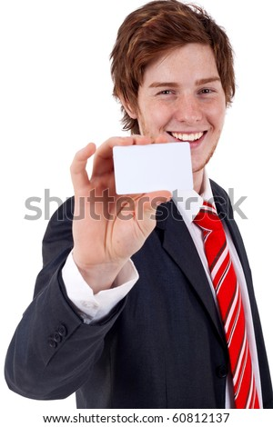 Young business man showing off his blank business card that is ready for text - stock photo