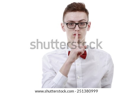 young business man showing silence gesture on white background - stock photo