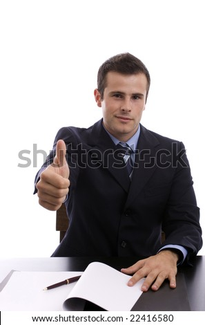 Young business man showing thumb up - focus on eyes