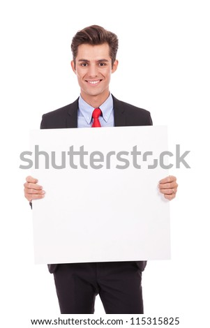 Young business man showing you blank board isolated on white
