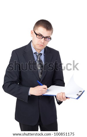 Young business man signing documents isolated on white background - stock photo