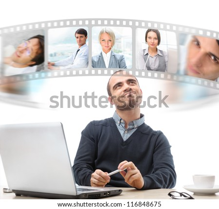 Young business man sitting at office communicating with his team across the world. International communications concept - stock photo