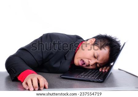 young business man sleeping on his laptop - stock photo