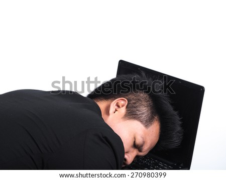 young business man sleeping on his laptop isolated on white. - stock photo