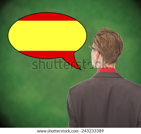 Young business man speaking spanish on school board background - stock photo