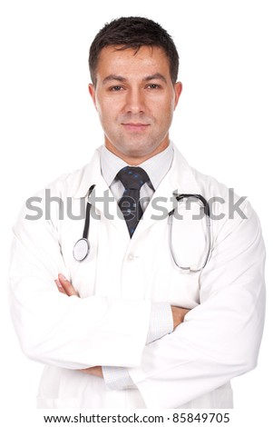 Young business man standing against the wall with crossed arms - stock photo