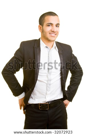 Young business man standing upright - stock photo
