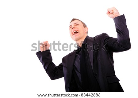 young business man standing with arms up in the air isolated on white background