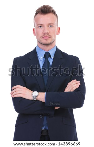 young business man standing with his hands folded while looking at the camera with a serious expression. on white background - stock photo